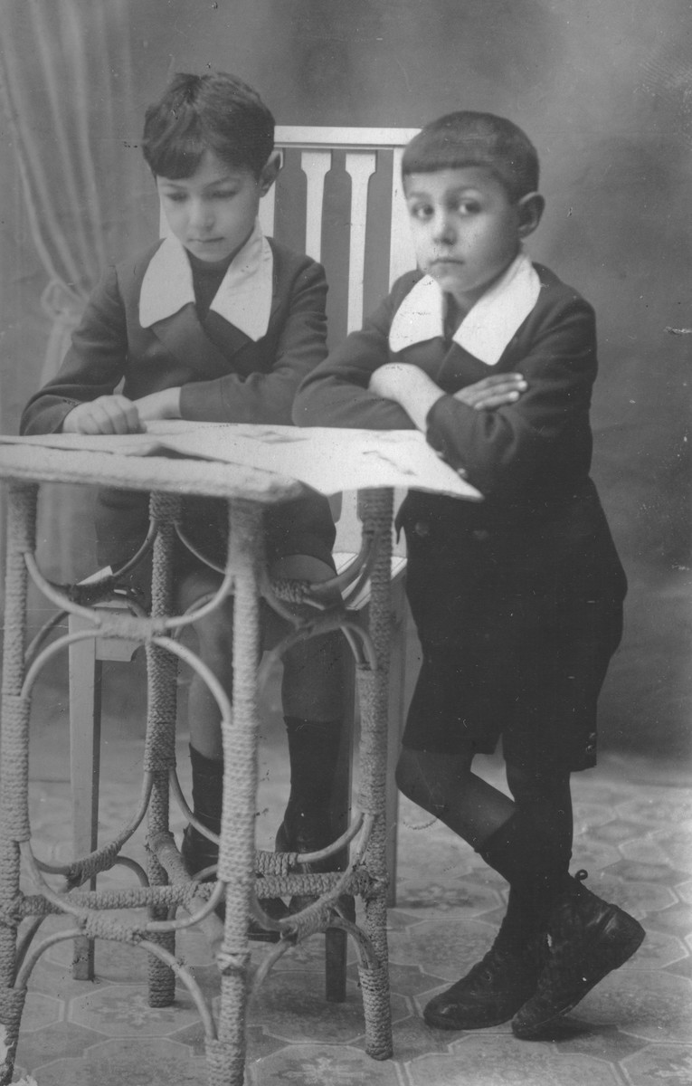 Studio portrait of two Jewish brothers in Salonika.  Pictured are Jacko (right) and Yehuda Beraha.