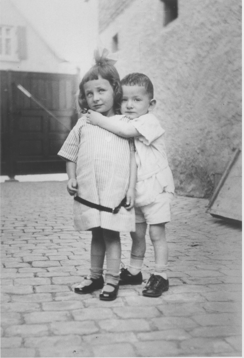 Two young Jewish siblings pose in the courtyard of their home in Guntersblum, Germany.  Pictured are Gretel and Otto Lichtenstein, cousins of the Rueb family,