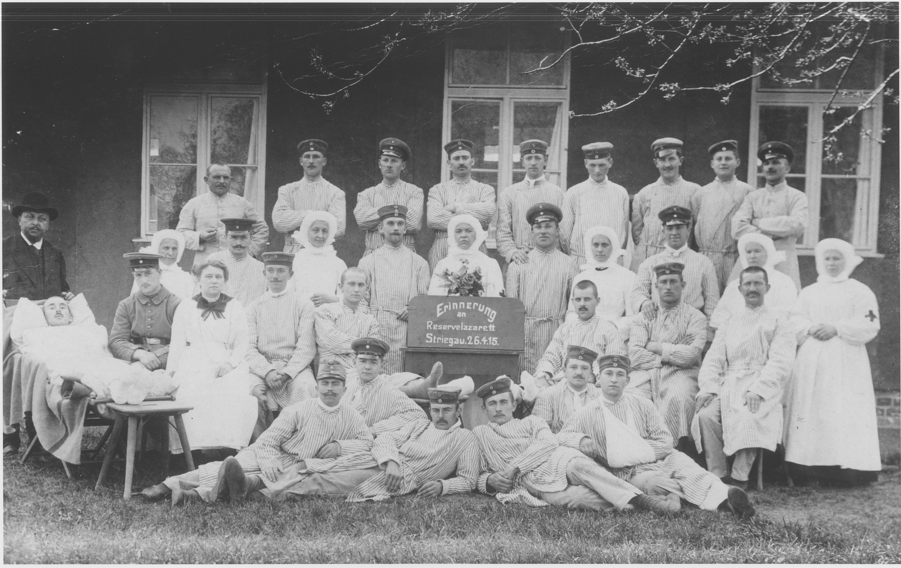 Group portrait of patients and staff of a German military field hospital in Striegau, Germany during WWI.  Among those pictured is Sigbert Loeb, the uncle of Manfred Loeb.