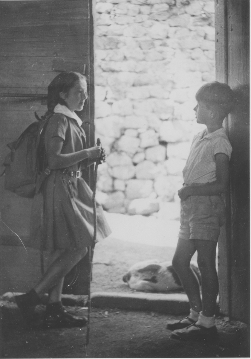 Nelly and Jean-Pierre Trocmé, the children of Pastor Andre and Magda Trocmé, with their dog Fido at the door of the rectory in Le Chambon-sur-Lignon.