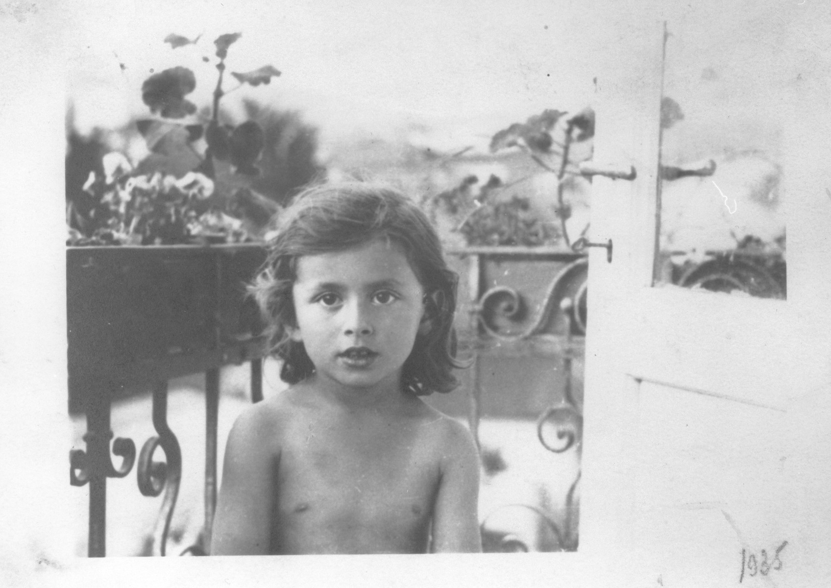 Portrait of a young Jewish girl, Lida Kleinman, sitting on the balcony of her home in Lacko, Poland.