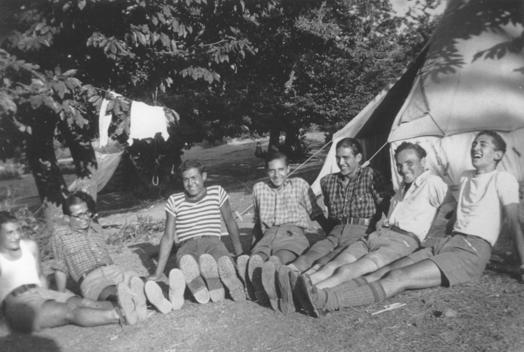 Group portrait of members of the Betar Zionist youth group on a camping trip.  Among those pictured is Jaco Beraha.