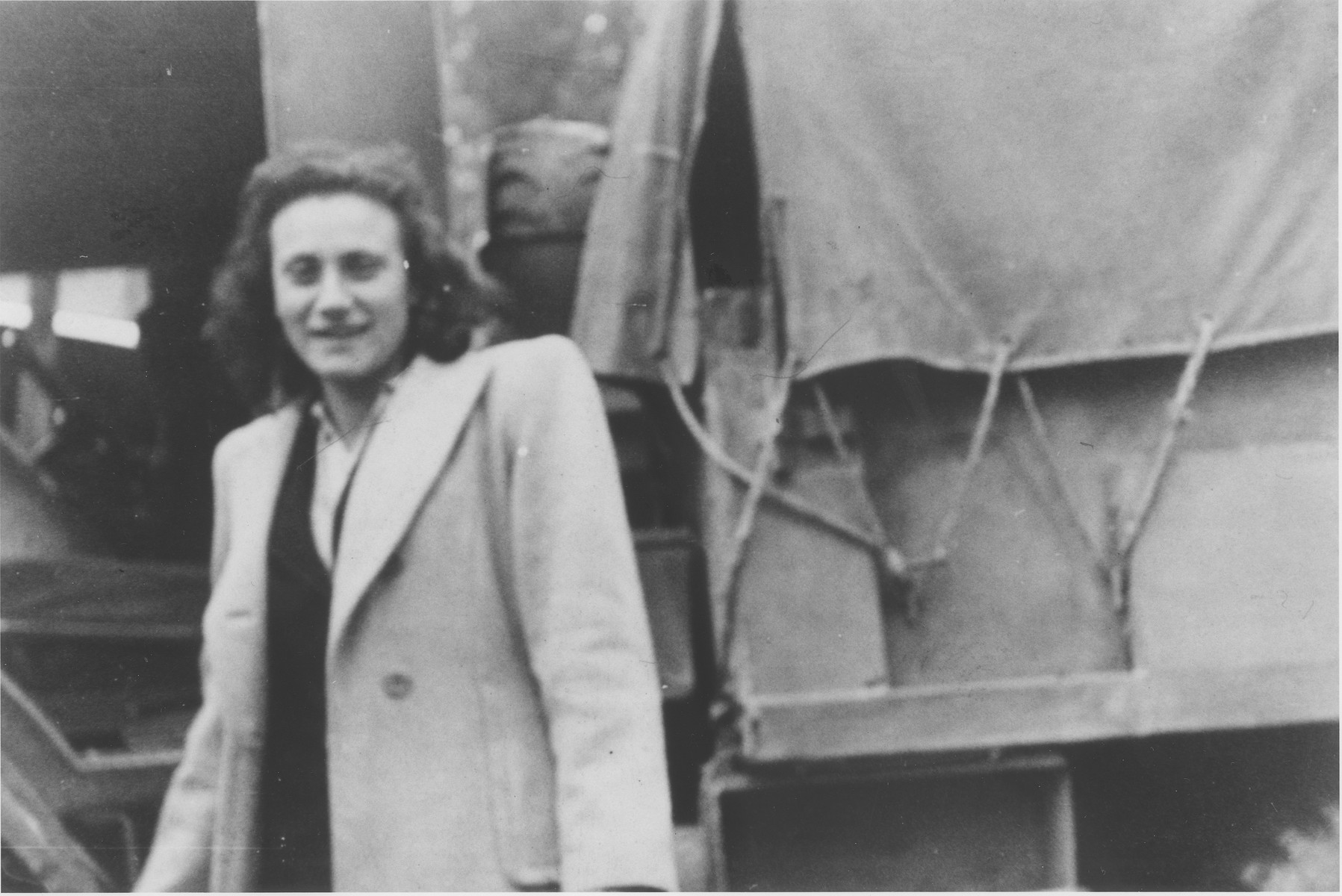 A female Bricha guide stands by a truck waiting to collect would-be Jewish immigrants to Palestine from the Hochland displaced camp and transport them to the French coast, where they will board illegal immigrant ships.