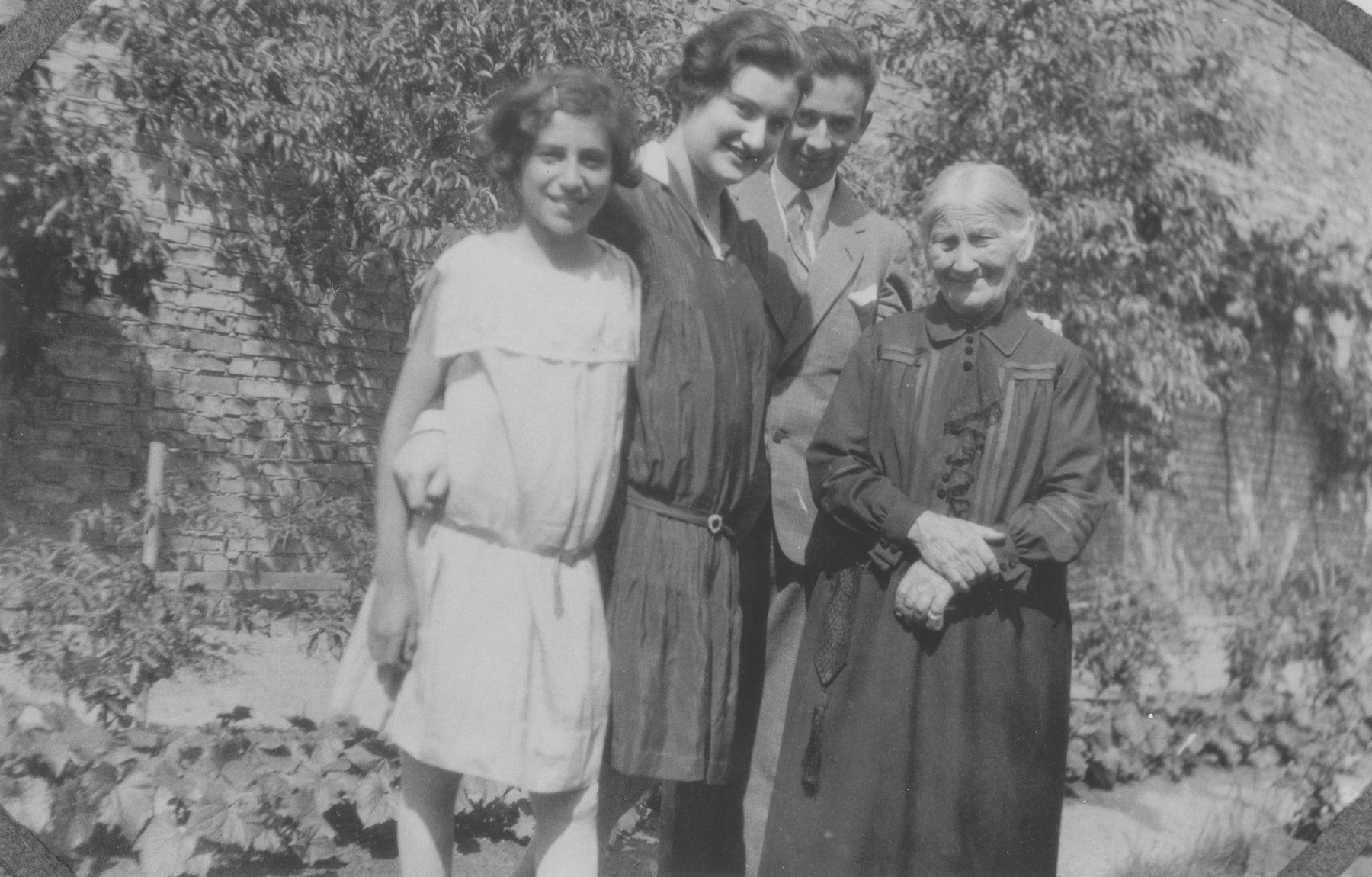 Portrait of members of the Rueb family in back of their home in Guntersblum, Germany.  Pictured from left to right are Beatrice Schlosser (visiting from New York), Hede Rueb, Emil Rueb and grandmother, Dina Rueb.