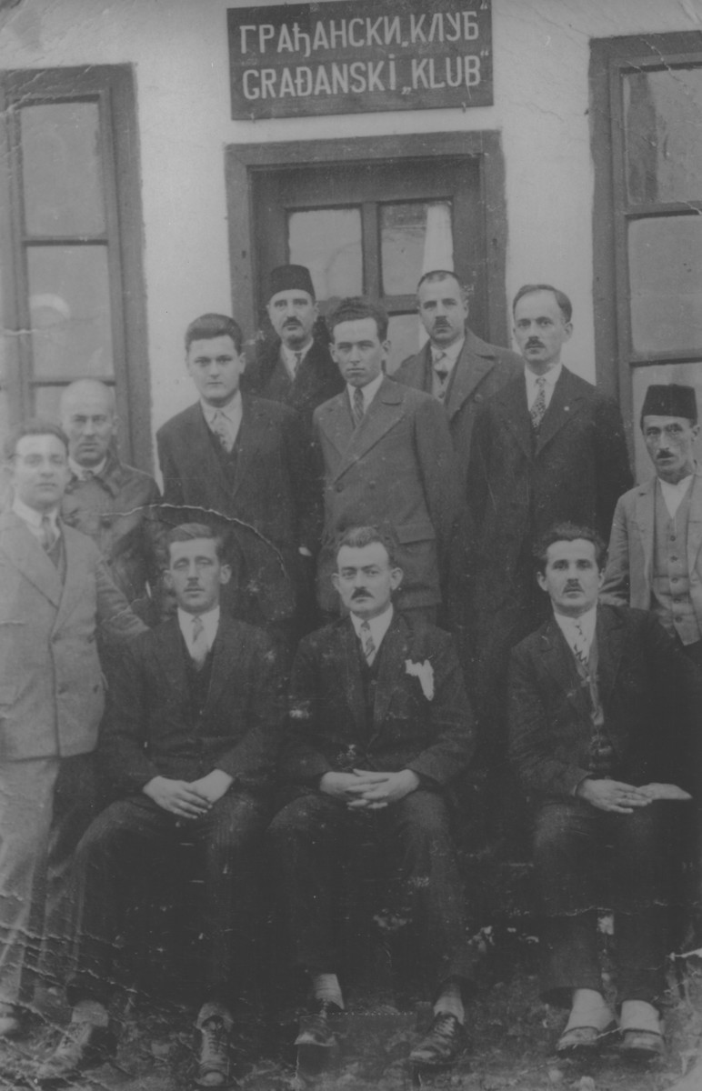 A group of Jews and non-Jews pose outside a club in Vlasenica, Bosnia.