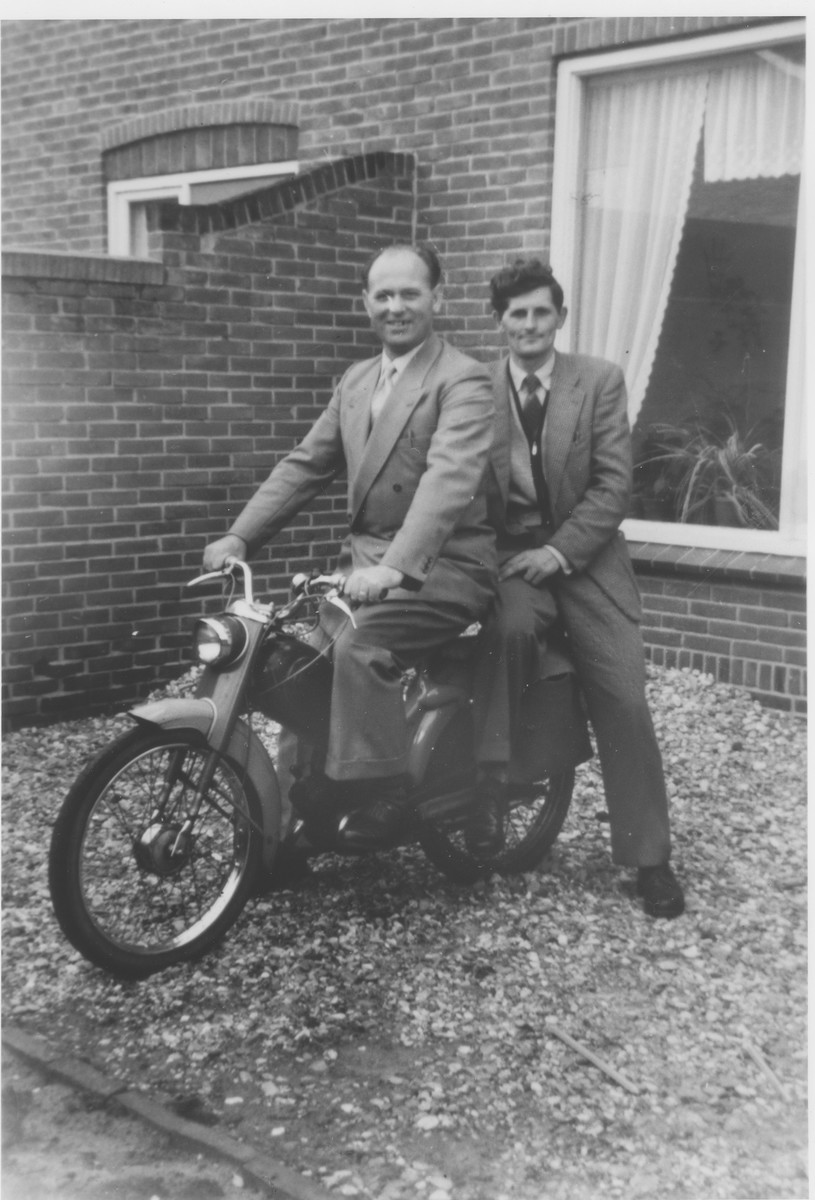 Two young Dutchmen pose on a motorcycle.  Pictured are Jan van den Berg (right), a Jehovah's Witness who was persecuted during the German occupation of the Netherlands, and Koos Lammers (left).