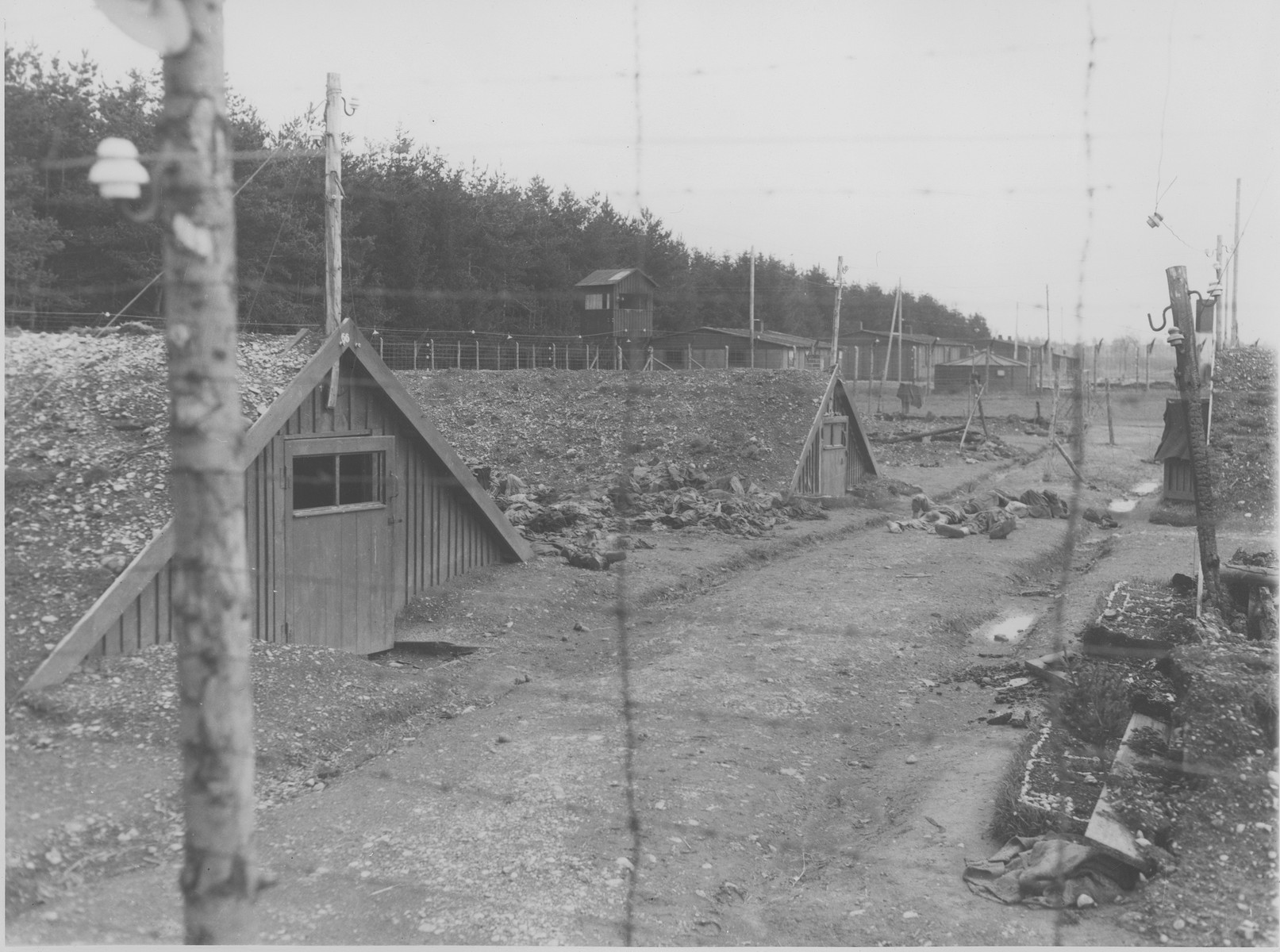View of a row of barracks at the Kaufering IV concentration camp soon after the liberation.