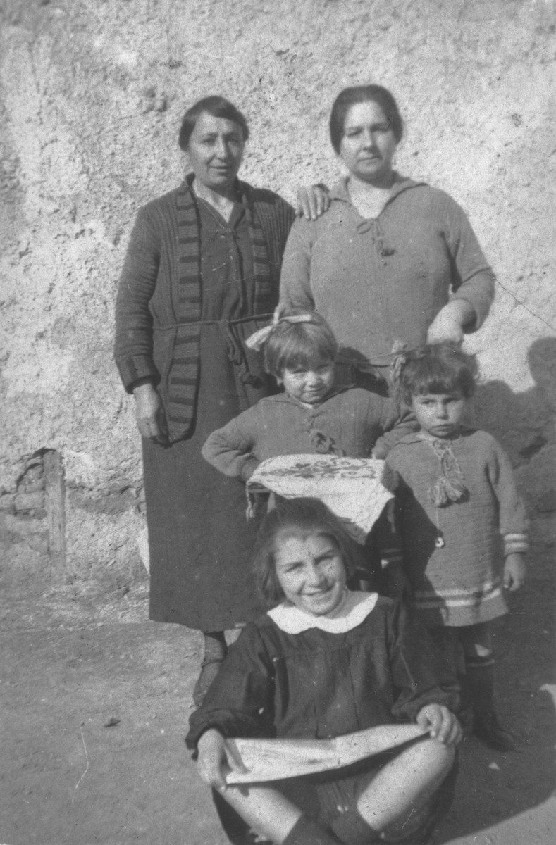 Portrait of the extended Beraha family in Salonika.  Among those pictured are Sol Beraha (top right), Baruch Beraha (center) and Miriam Beraha (front).