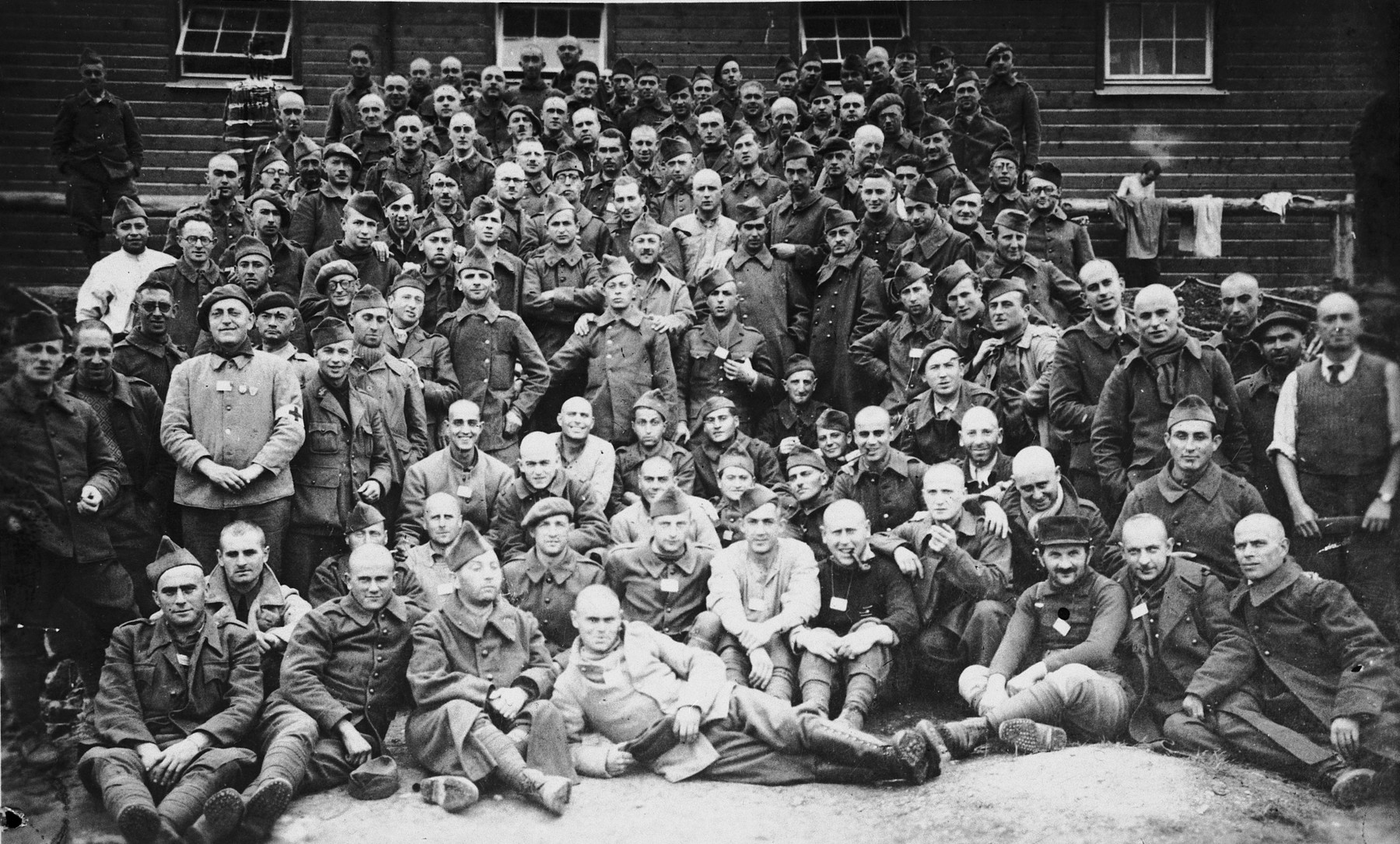 Group portrait of French POWs in Stalag XVIII.  Among those pictured is the uncle of Marianne Schwab in the lower left corner.