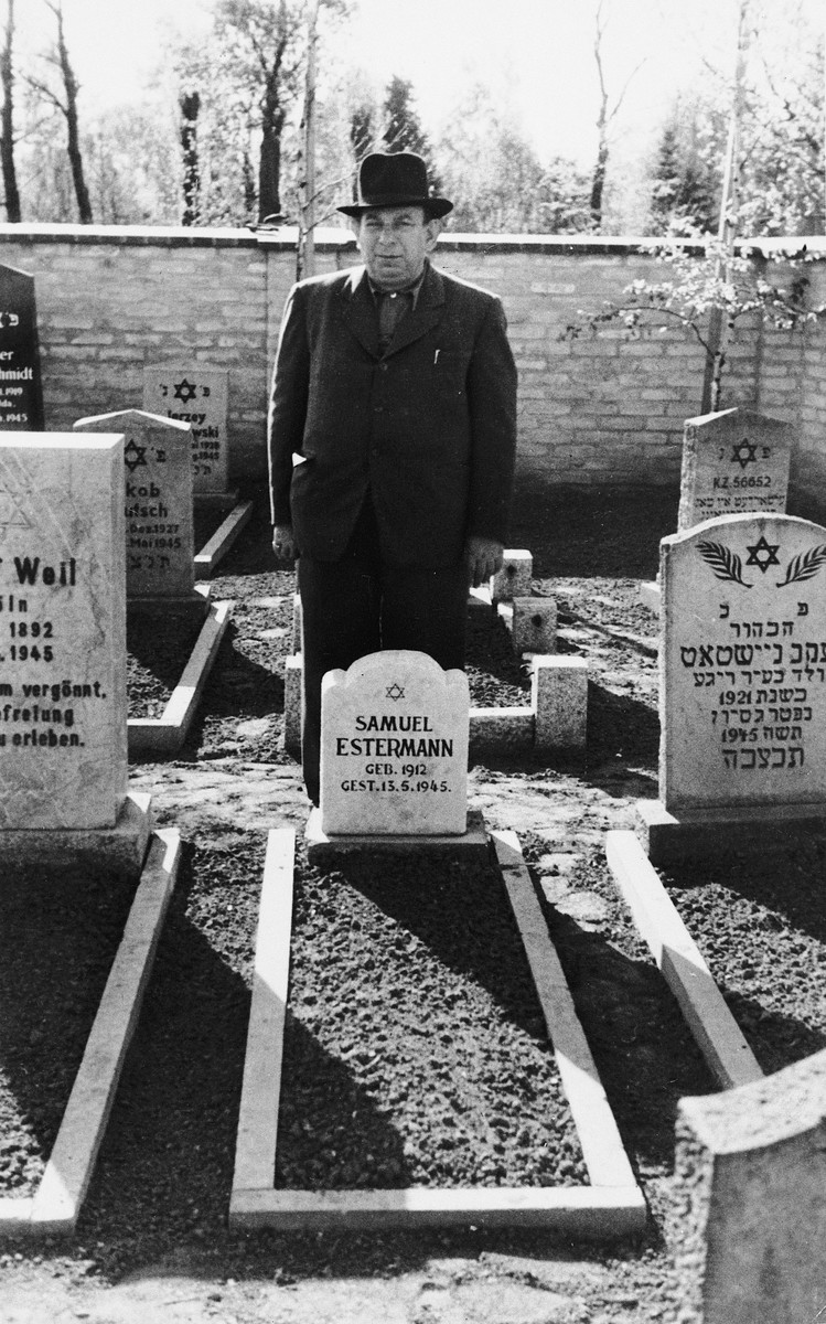 Natan Roloff  pays his respects next to the grave of Samuel Estermann in the Jewish cemetery in Neustadt.