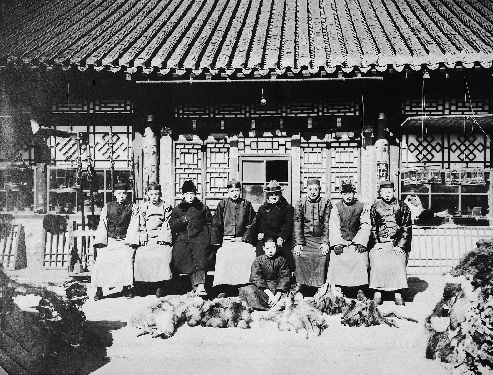 Chinese and Jewish workers pose outside  Paul Toper's fur export business.  Grisha Toper is third from the left.