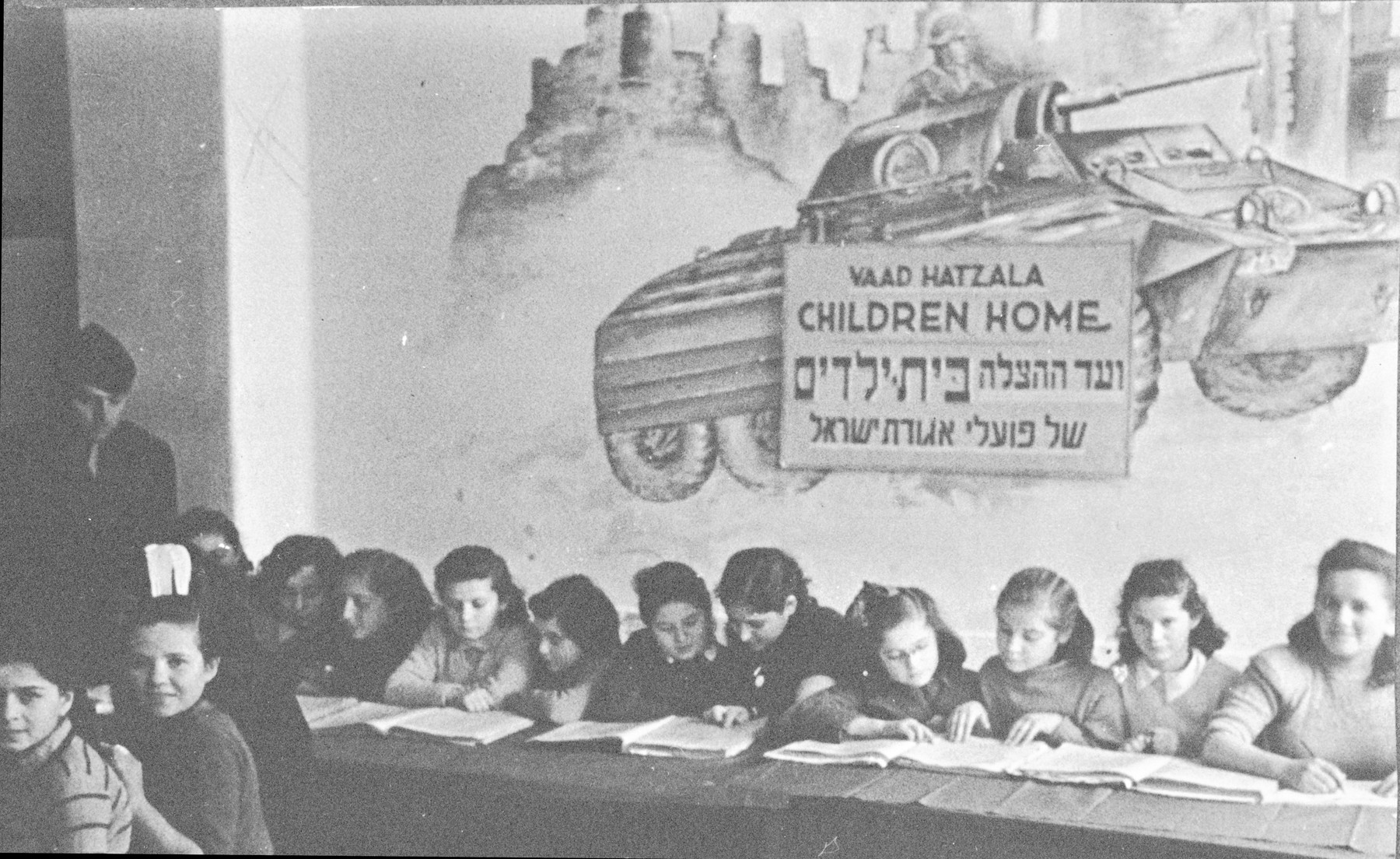 School girls study a religious text in the Poalei Agudat Yisrael children's home in Ulm run by the Vaad Hatzala.