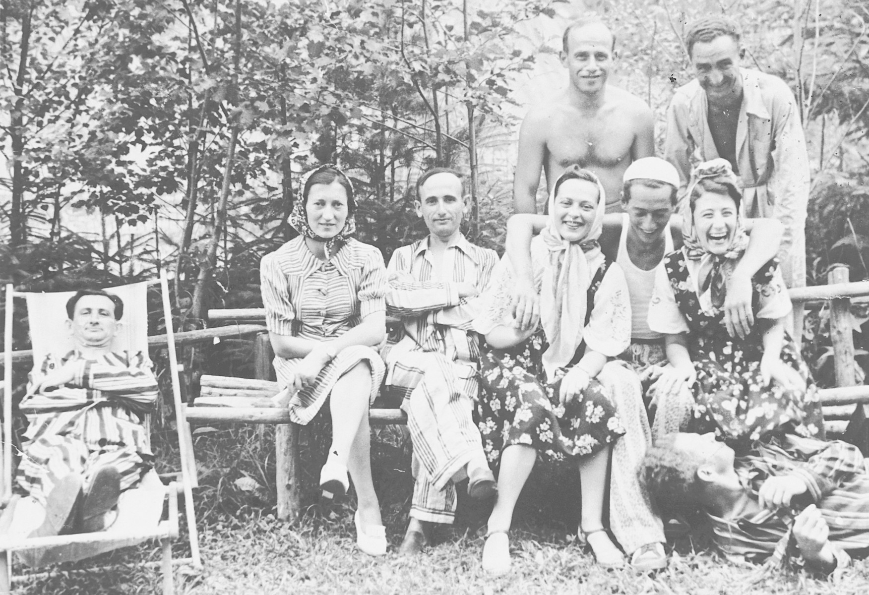 """A group of young adults relaxes at a resort """"Albina Färbera"""" in the woods [probably in the vicinity of Obertin].  Among those pictured is Simon Ruder."""