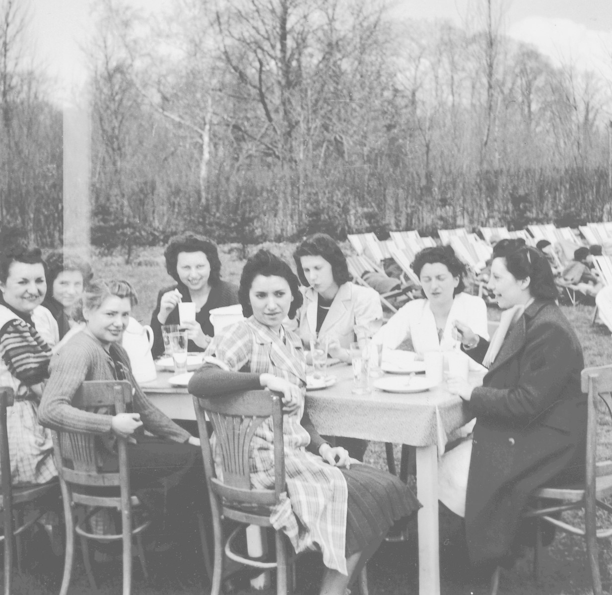 Belgian rescuer, Jeanne Daman and other teachers eat outside [probably in the Nos Petitis kindergarten.]