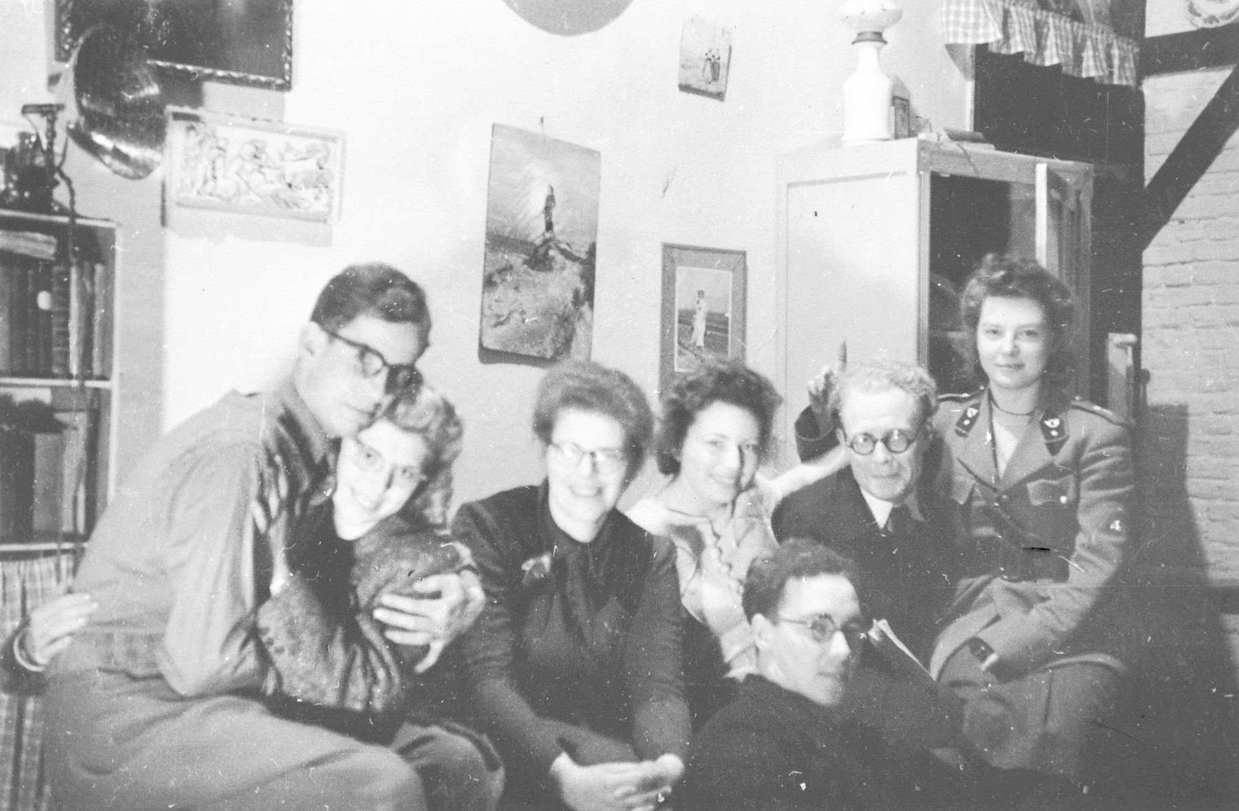 Group portrait of young people gathered in an apartment in Brussels.  Among them is Jeanne Daman (center) who played a major role in resistance and rescue two years later.  Also pictured are Paul, Georgette and Henri Gazan.