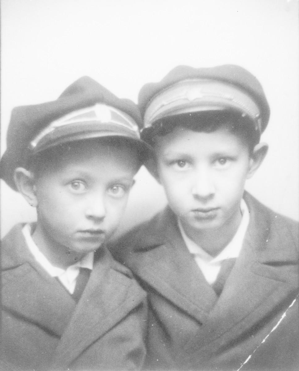 Close-up portrait of Yehuda (Yulik) and Israel (Srulek) Dubner wearing their school caps.
