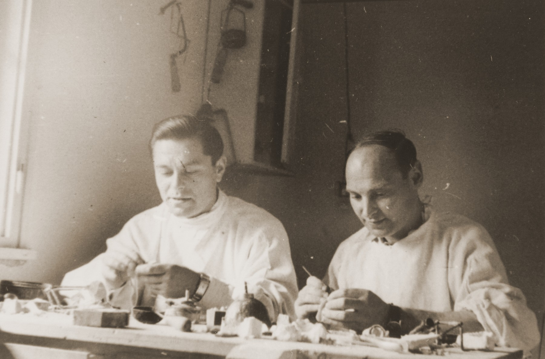 Dental technicians prepare molds in the Neu Freimann displaced persons camp.