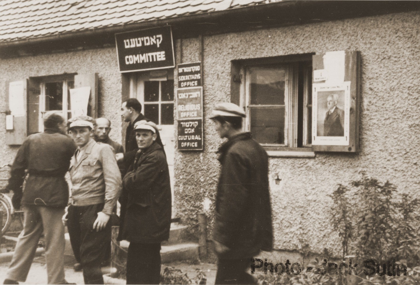 Residents wait outside an administrative building in the Neu Freimann displaced persons camp.