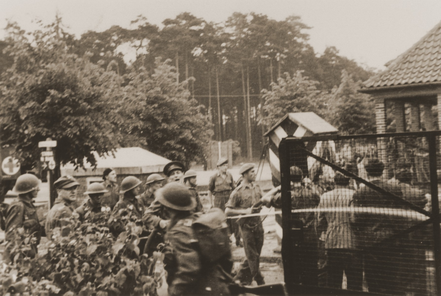 British soldiers guard the entrance to the Bergen-Belsen displaced persons camp.