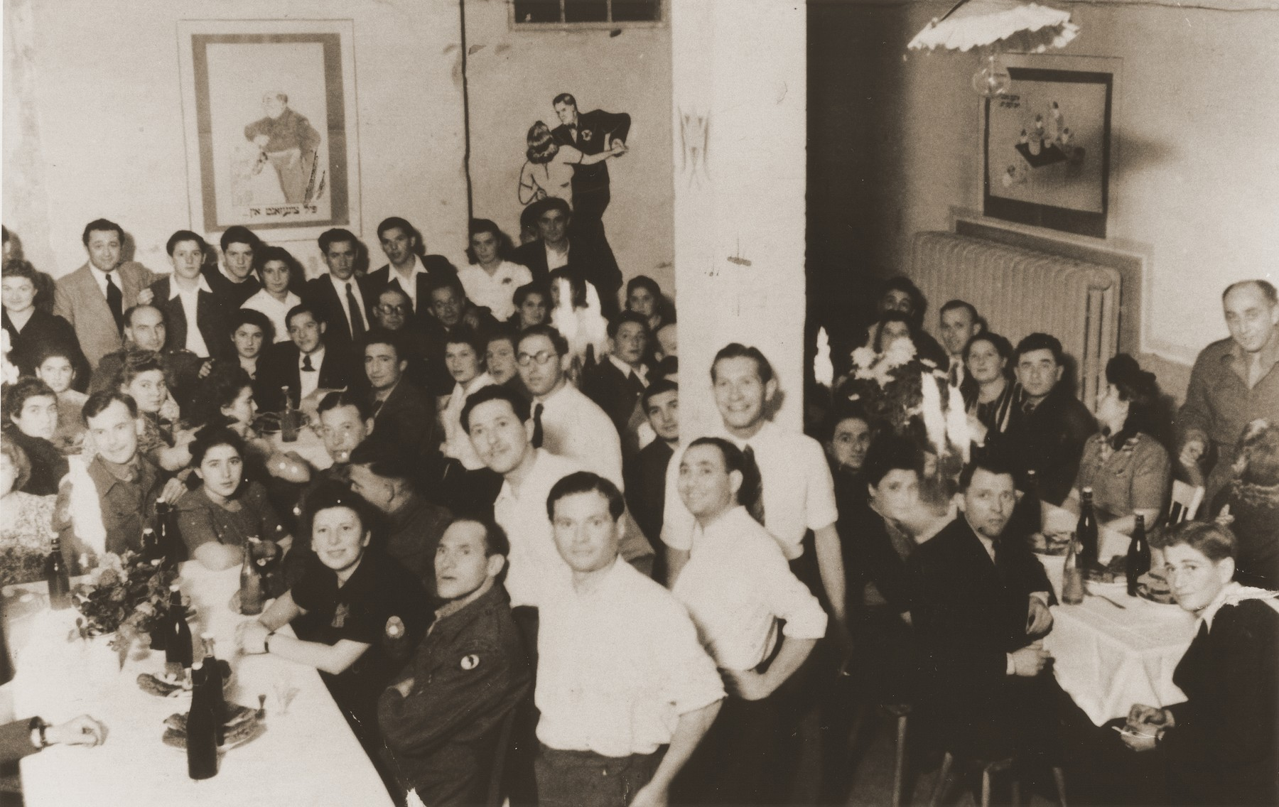 Jewish residents and British soldiers attend a party in the Vinnhorst displaced persons center.  Included in the photo are Manek Lipke. Halinka Lipke, Nadia, Tola Pilcewicz, Herman Zelman, Chaska Lipke, Monya Sender and Kapelusz. The latter was drowned in a lake after being forcibly held underwater by antisemtiic German boys.