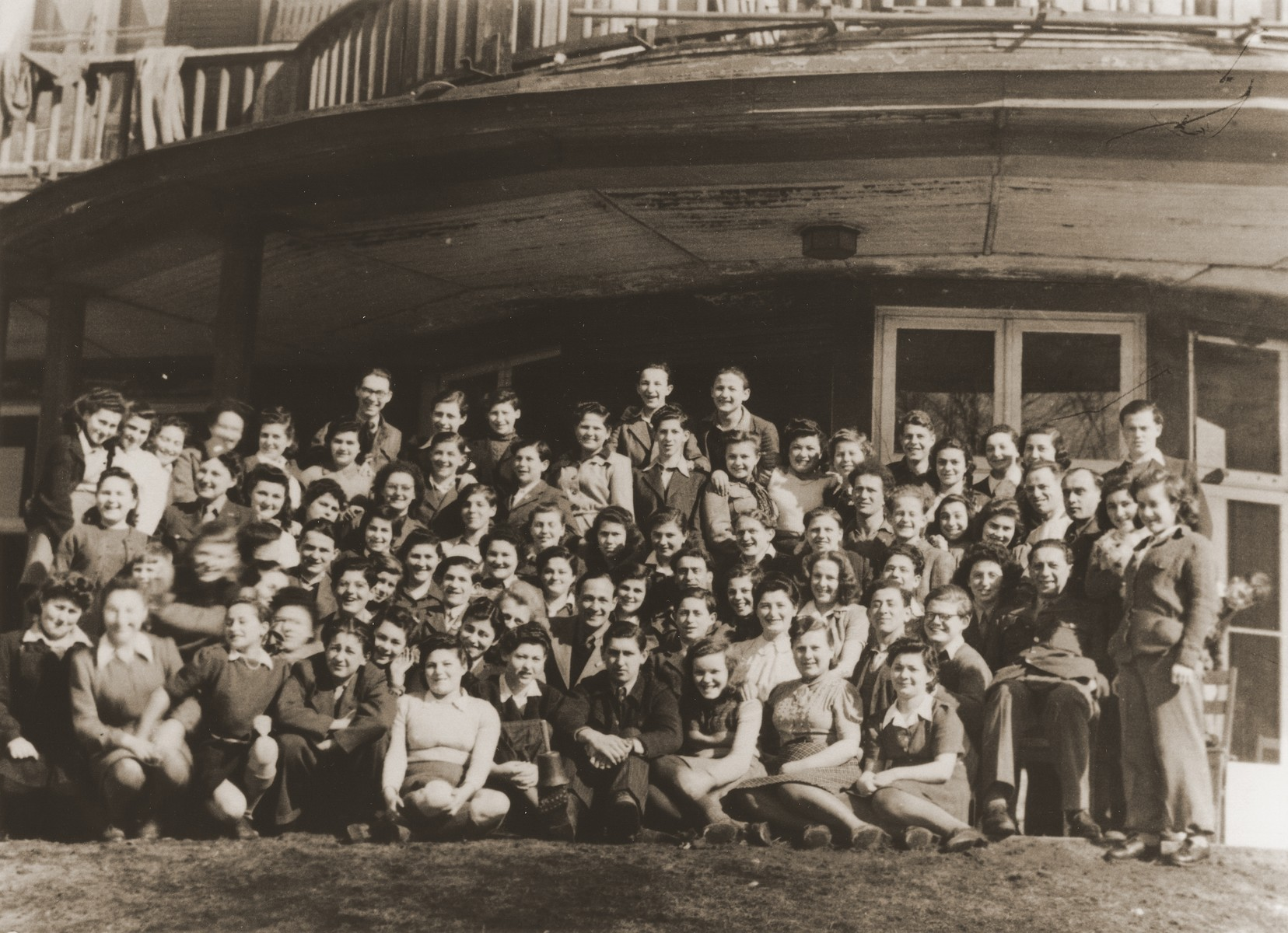 Group portrait of DP children from the Bergen-Belsen displaced persons camp at the Warburg children's home in Hamburg-Blankenese.  Among those pictured are Penina Zidnir, David Gur-Aryeh, Tzvi Zohar, Dushya Shifron, Arieh Swartz, Yochevet Adler, Mordechai Shmanovitz, Shifra Ziskand, Inge Grundel and Herbert Grunde.  Pictured in the front row, second from the left, is Halina Danziger.  Pictured in the third row, seated far left, is Egon Fink, who worked for the AJDC.