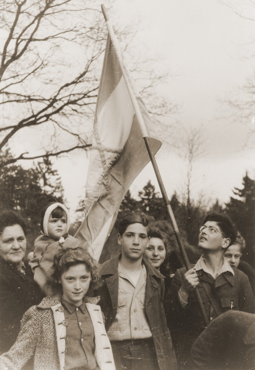 DP youth pose with a Zionist flag at the children's home in Blankenese, shortly before their departure for Palestine.