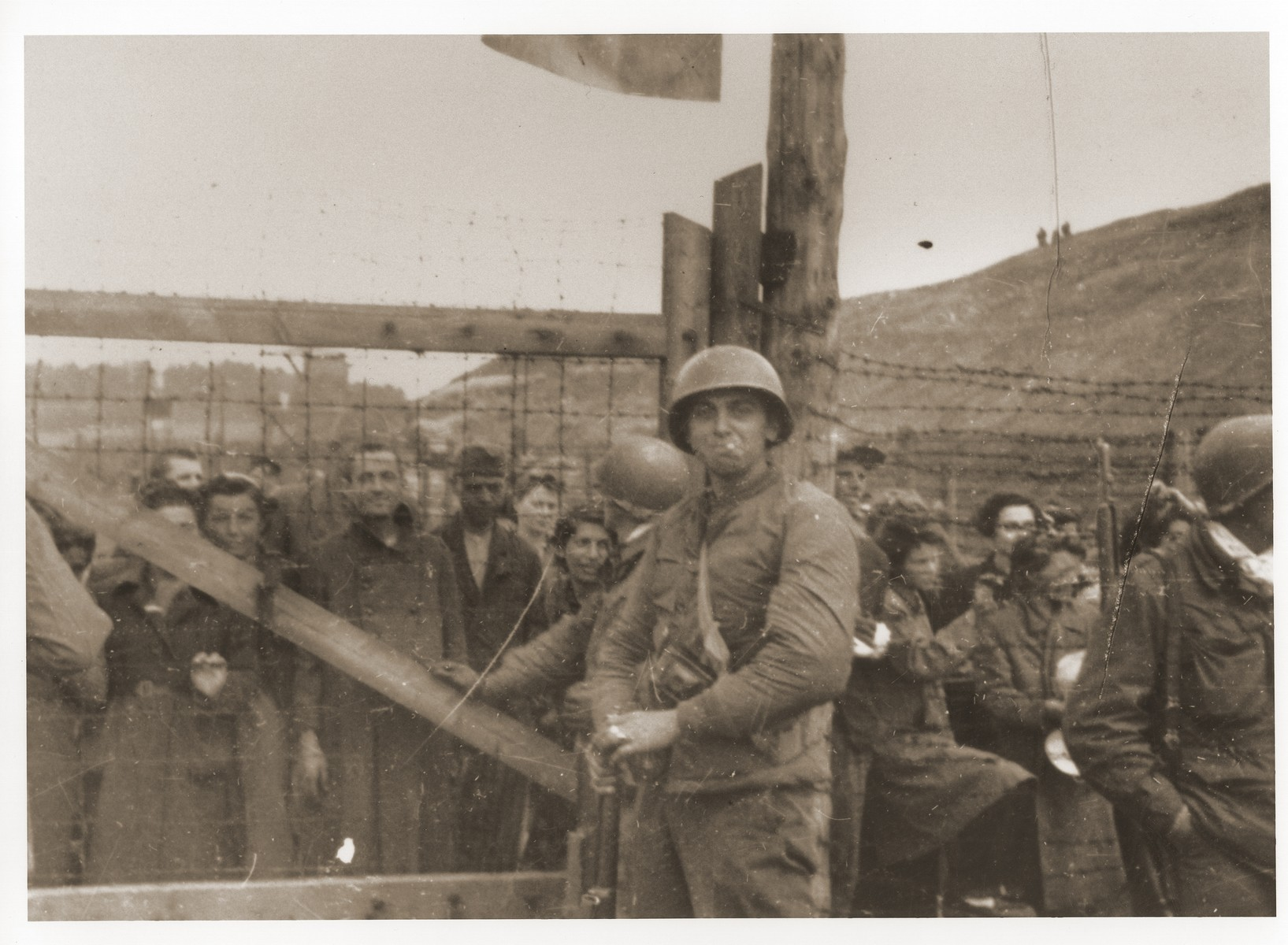 U.S. troops guard the entrance to the Russian camp at Mauthausen, which was under quarantine.