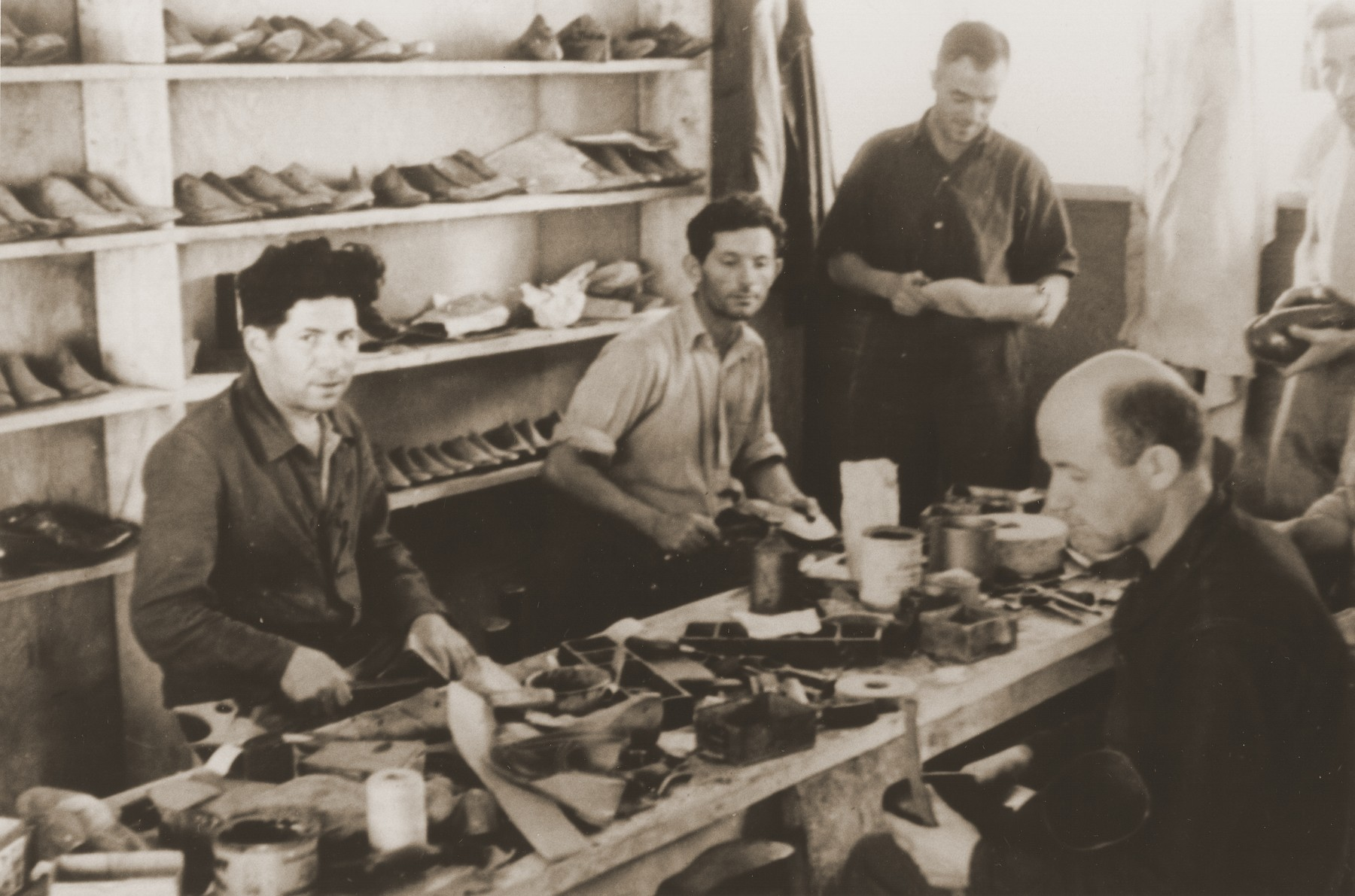 Cobblers make shoes in the Neu Freimann displaced persons camp.