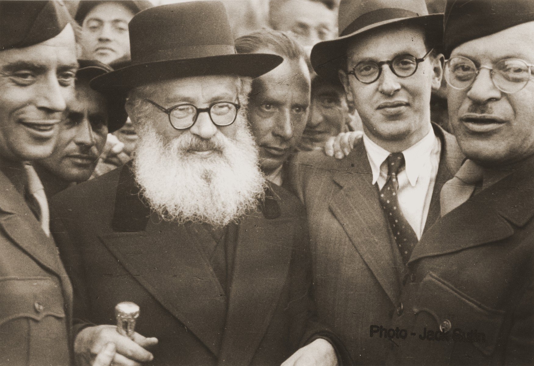 Rabbi Isaac Herzog, Ashkenazi chief rabbi of Palestine, attends a Zionist demonstration during an official visit to a displaced persons camp.