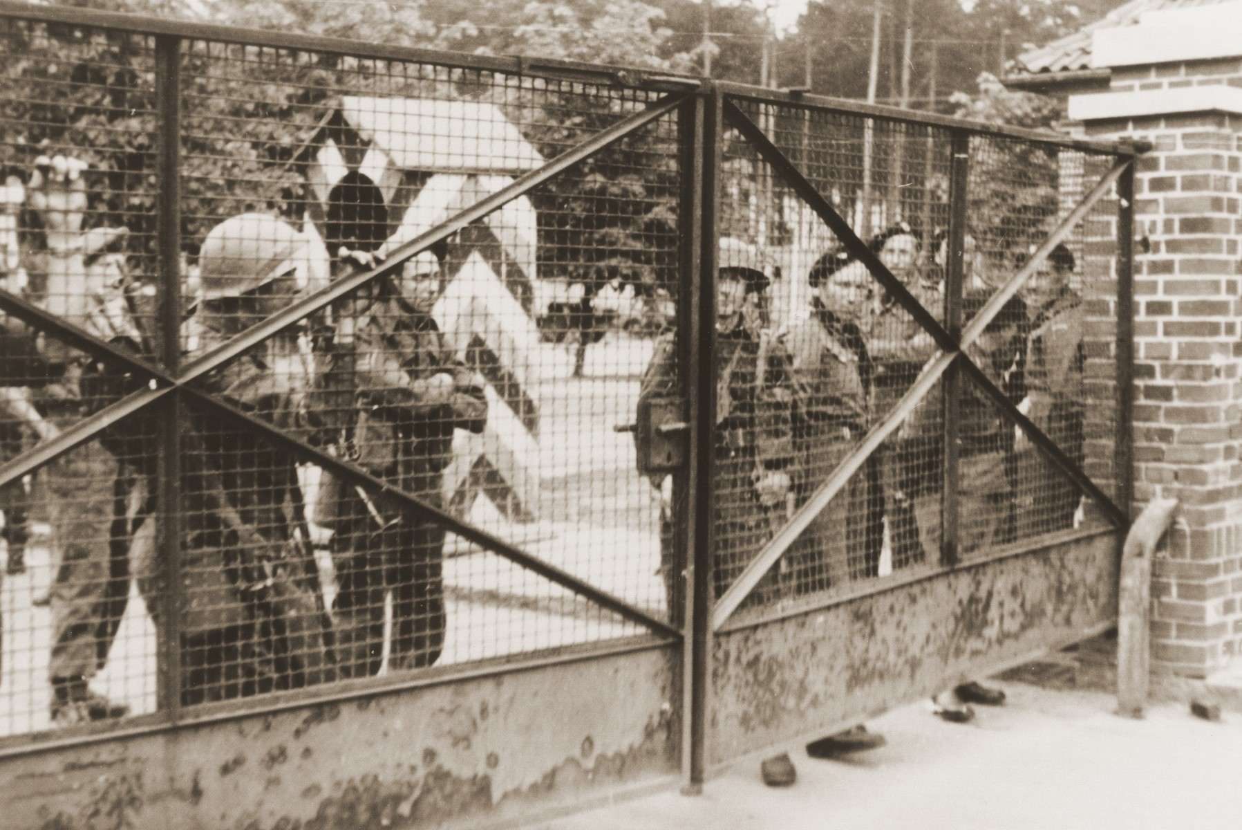 British soldiers stand guard outside the closed gates of the Bergen-Belsen displaced persons camp.
