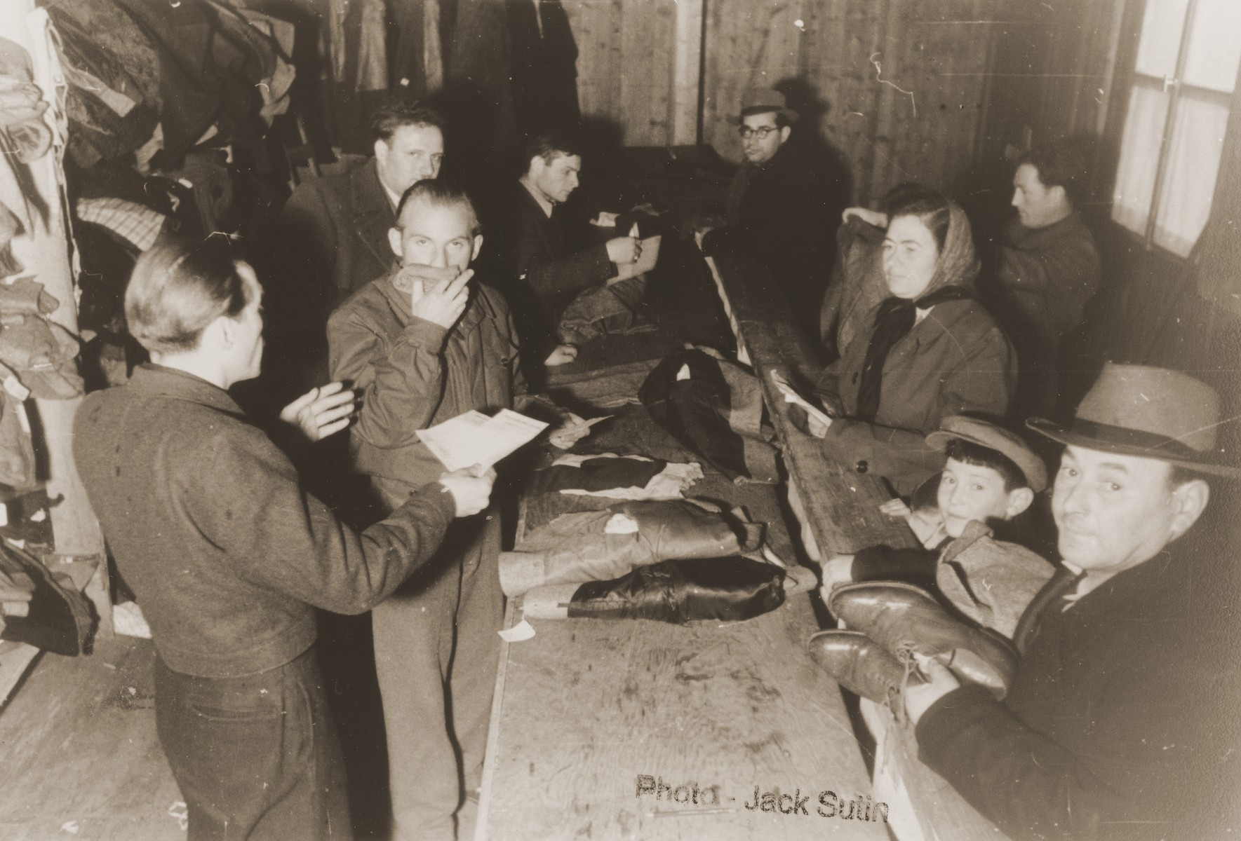 Clothing distribution center in the Neu Freimann displaced persons camp.    Camp administrator, Izik Sutin, stands third from the left.