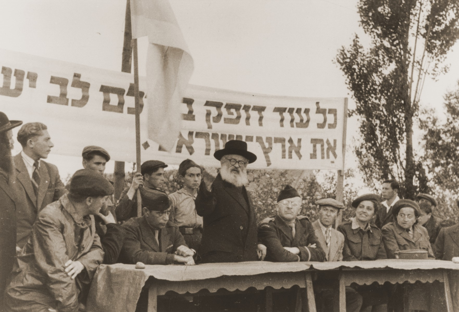 Rabbi Isaac Herzog, Ashkenzi chief rabbi of Palestine, delivers an addresses a Zionist rally at the Neu Freimann displaced persons camp.
