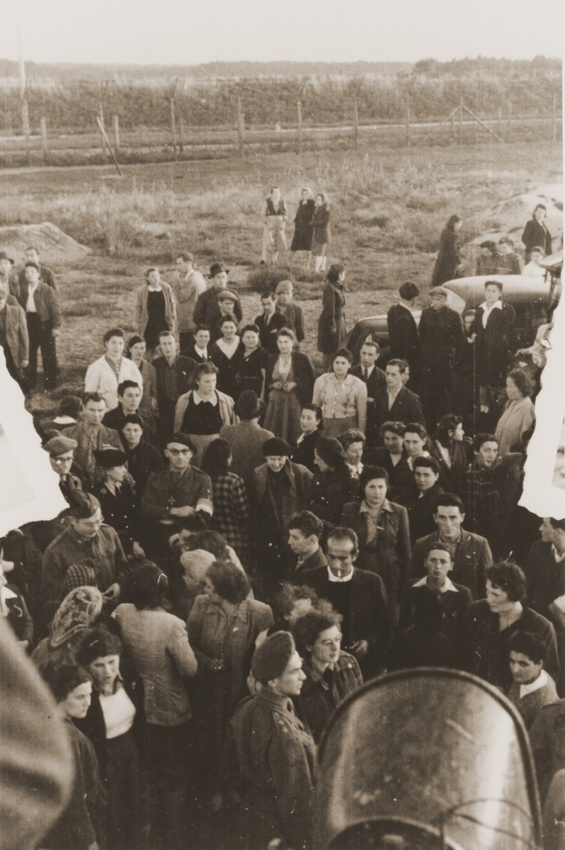 Jewish DPs are gathered in an open field in the Bergen-Belsen displaced persons camp.