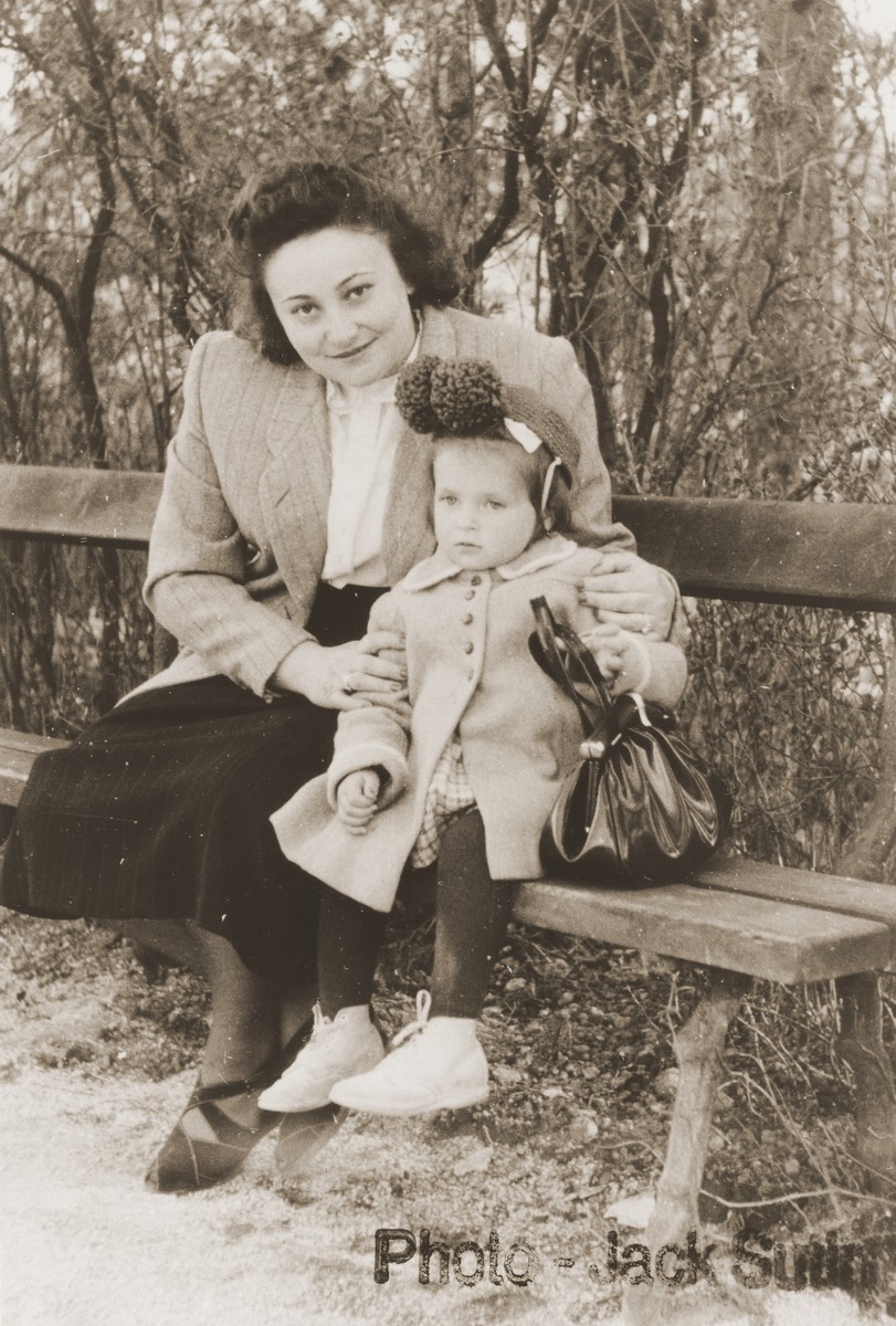 Rochel Sutin sits with her daugher, Cecilia, on a park bench in the Neu Freimann displaced persons camp.