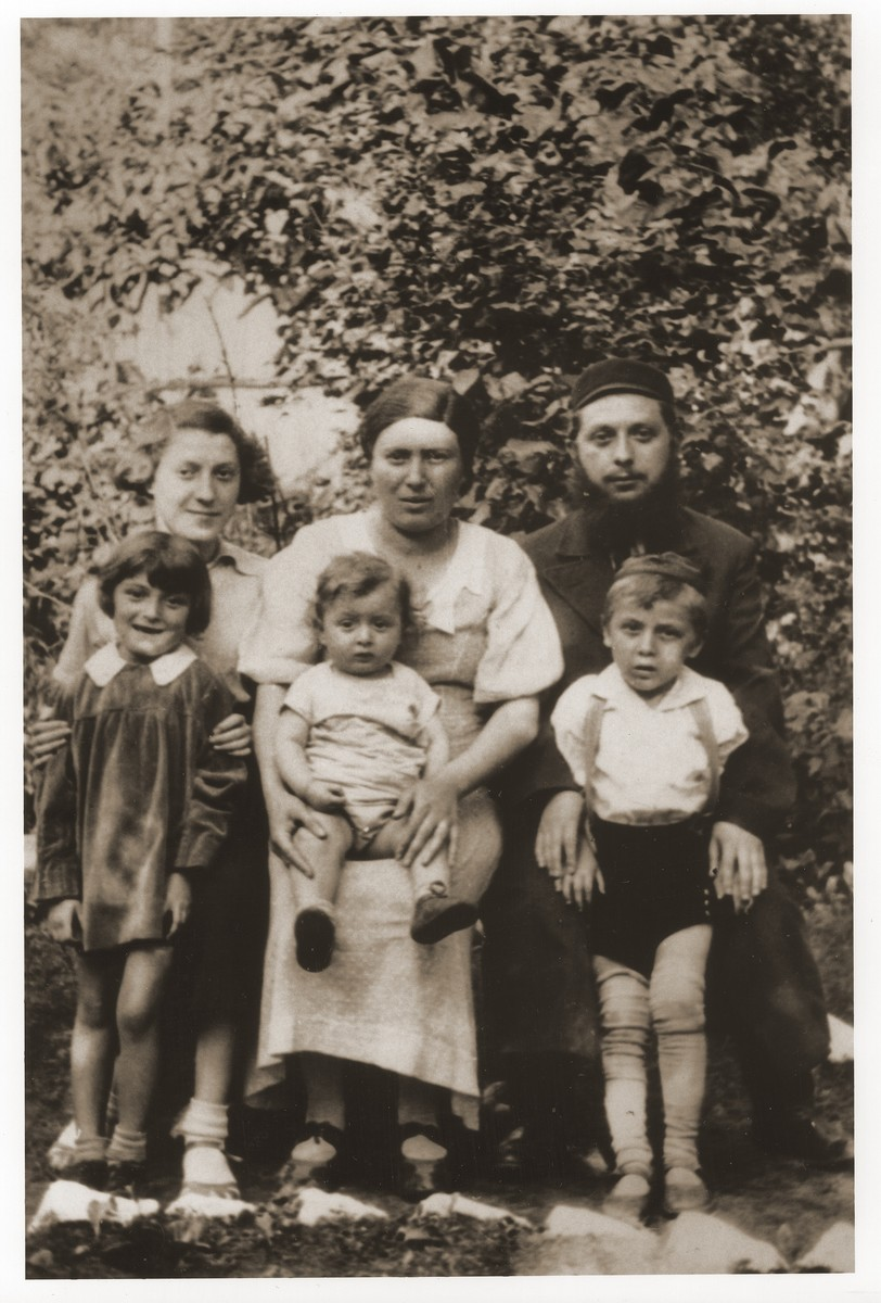 Portrait of the Tenenbaum family taken on the eve of Estera's departure for the United States.  Pictured in the back row from left to right are: Estera Tenenbaum, Fajgl (Warszawska) Tenenbaum and her husband, Pinchas Tenenbaum.  In front are Fajgl and Pinchas' three children.