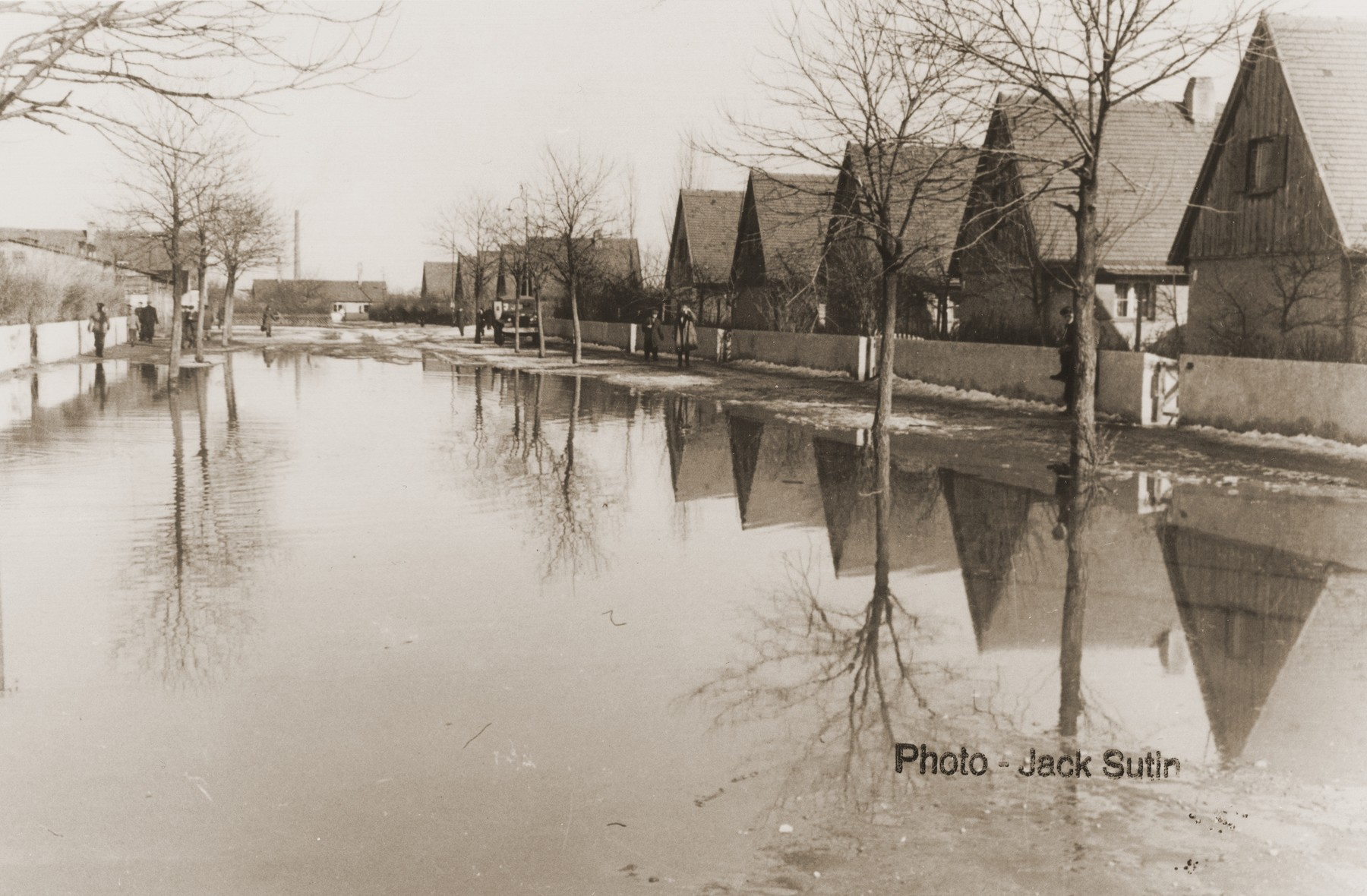 View of a flooded street in the Neu Freimann displaced persons camp.