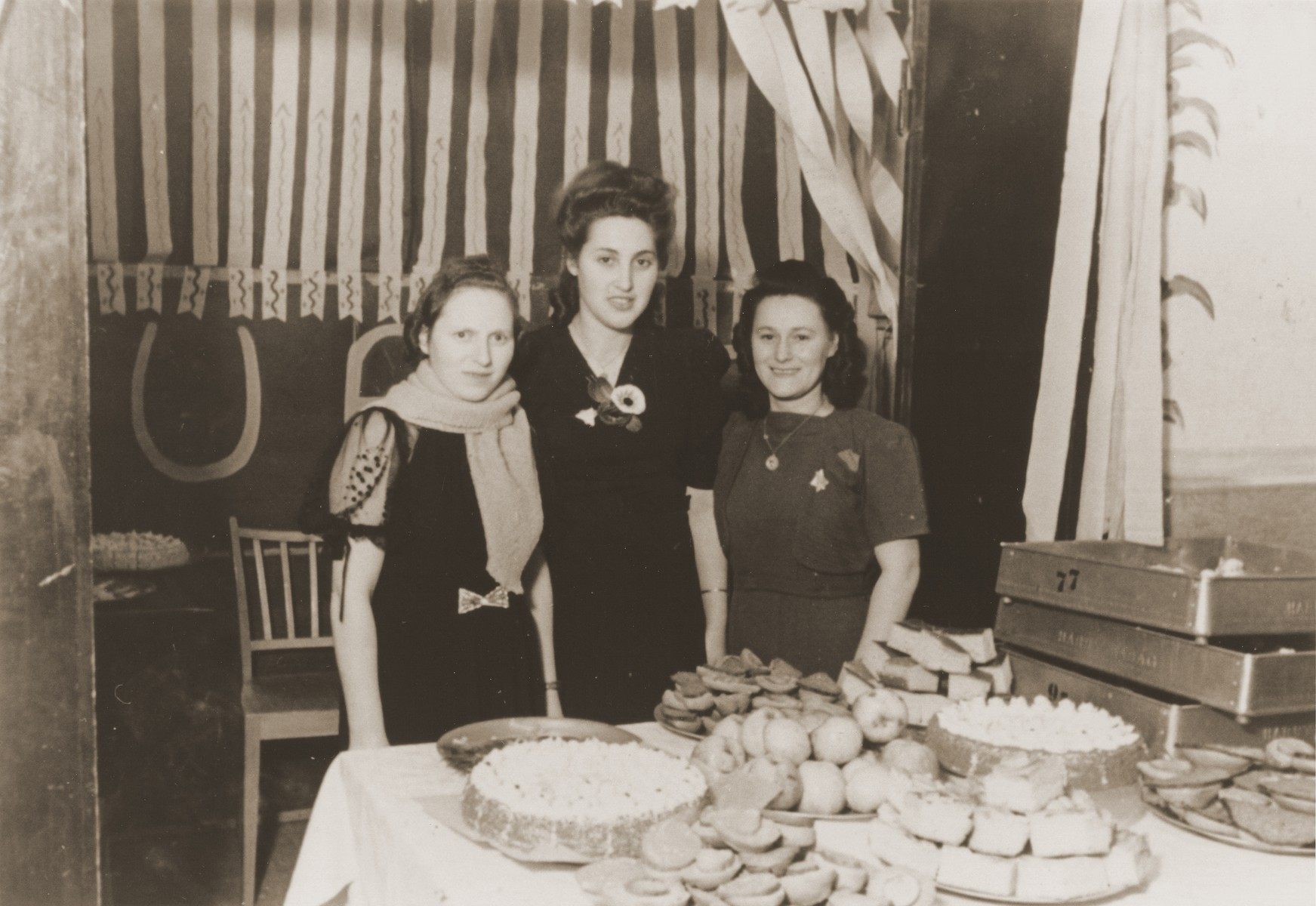 Mania Mell and Pola Rejchman set out refreshments for a party in the Vinnhorst DP center.