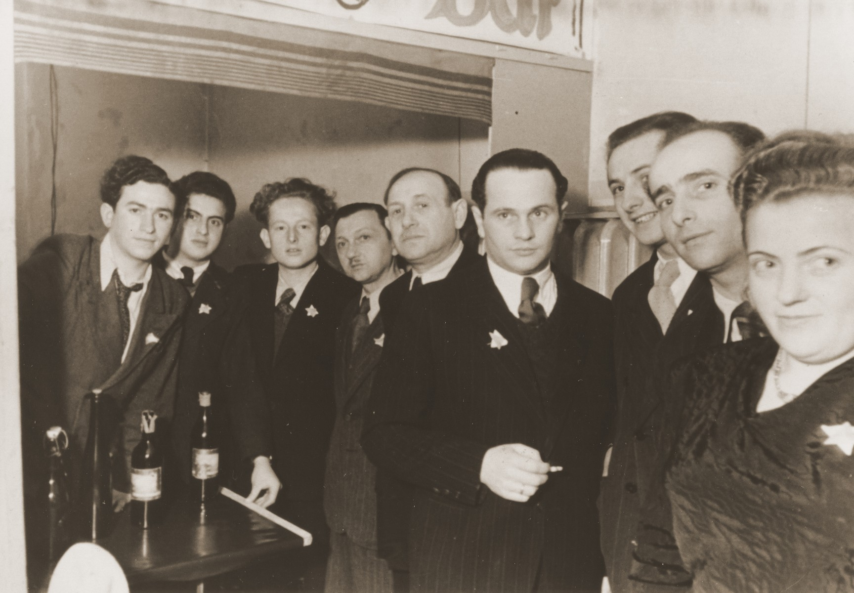 Jewish DPs wear small Jewish stars on their lapels at an engagement party at the Vinnhorst displaced person's center.  Included in the photograph are Israel Zaks, Mietek Zawadzki and Nathan Teichner.  Frieda Altman ( maiden name Lerner) is standing next to her husband,  Morris Altman.