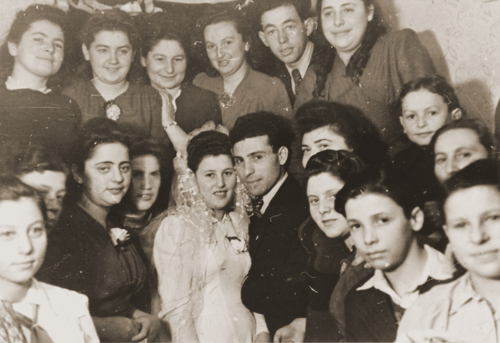 A Jewish bride and groom pose with their family and friends in the Neu Freimann displaced persons camp.  Pictured are the newlyweds, Samuel and Lilly Scherb.