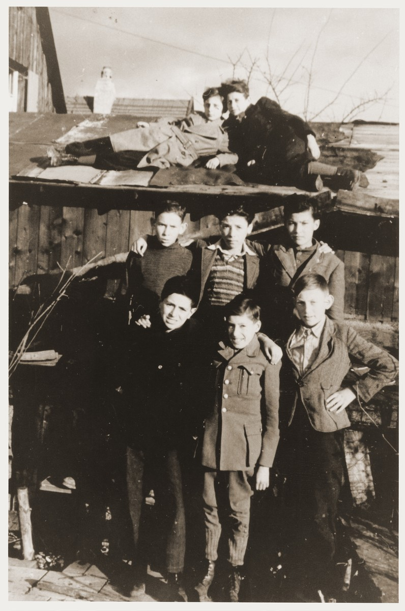 Group portrait of children in the Neu Freimann displaced persons camp.    Pictured in the center is Nachman Aaron Elster.