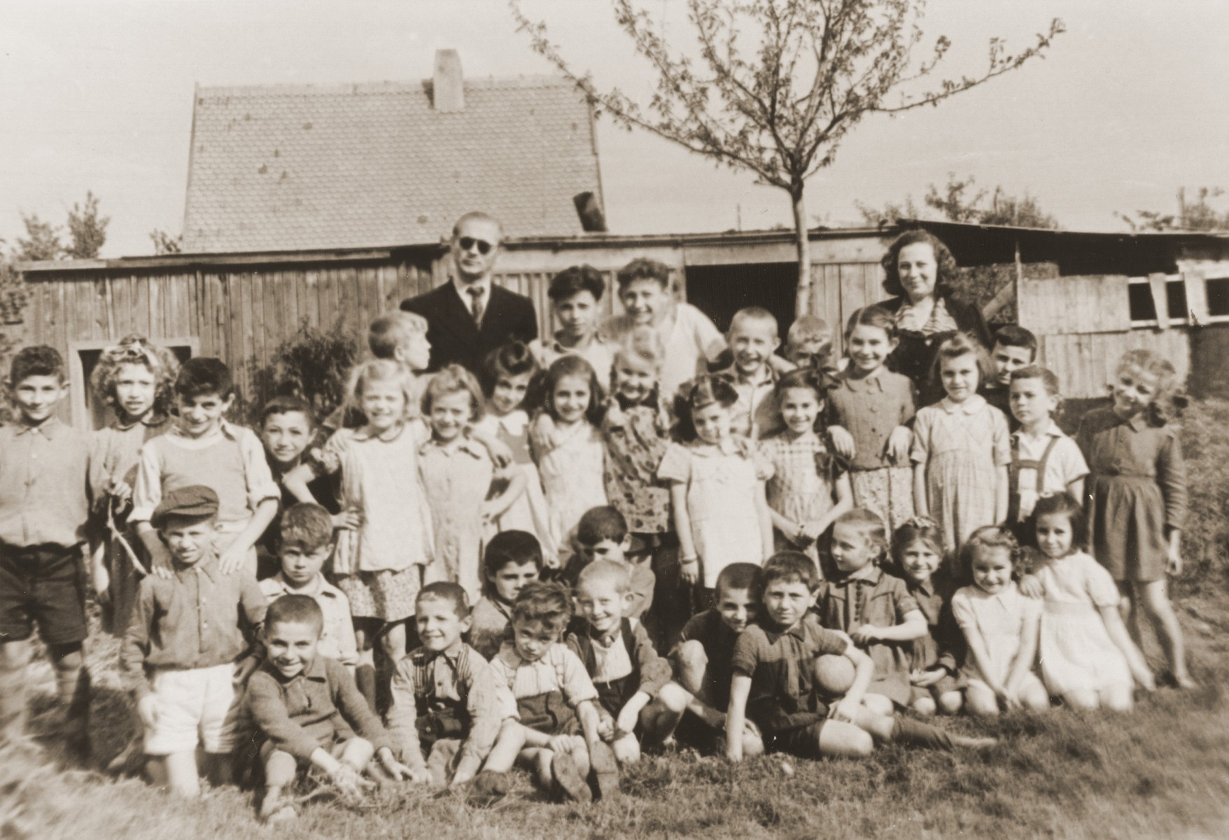 Group portrait of a class of school children in the Neu Freimann displaced persons camp.