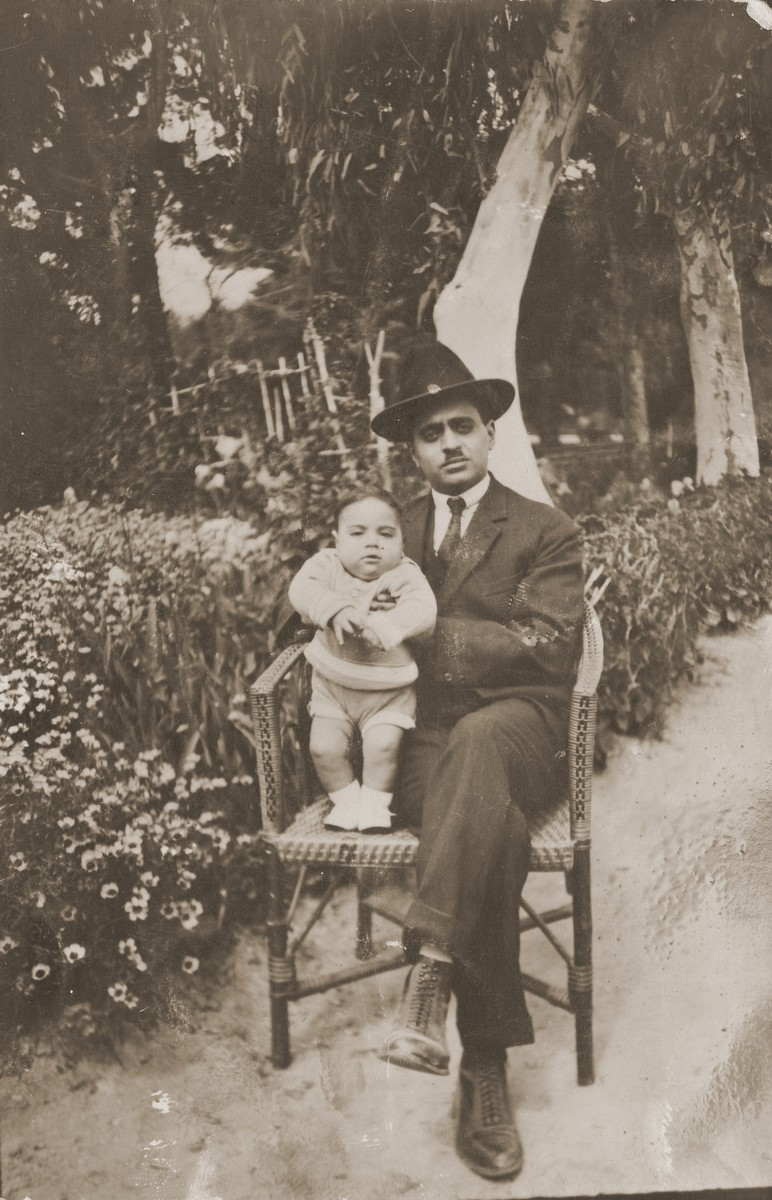 Jacob Mordo with his infant son.