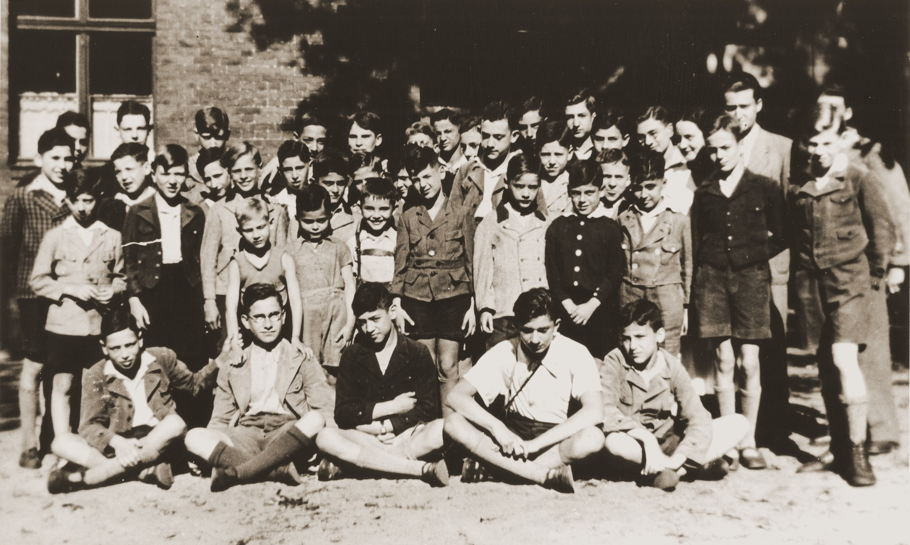 The children living at the Baruch Auerbach Jewish orphanage in Berlin.  Ralph Moratz is standing directly behind the second boy in first row from left and Wolfgang Grajonjz is standing directly next to Ralph on the right (his head is turned downward).
