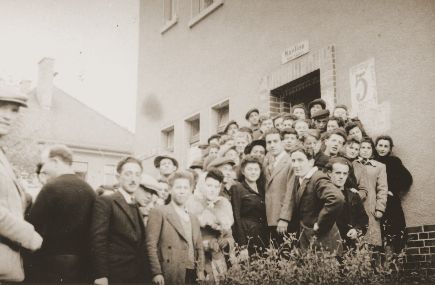 DPs stand outside their block in Belsen DP camp.  Dora Friedfertig is standing in the front row, third from the right.  Stefa Fiedfertig was born in the Lvov ghetto on February 28, 1942.  Prior to the war her father Israel worked in a chocolate factory.  Her mother Dora Odower Friedfertig was a housewife.  After a year, in June 1943, Dora brought Stefa to Josef and Maria Amborski who hid her for the duration of the war.  Originally they also hid Dora who posed as Josef's sister, but she eventually had to leave.  After the war, Dora and Stefa were reunited, but Israel had perished.  Dora and Stefa stayed in the Belsen DP camp before coming to the United States in June, 1950 on board the General House.