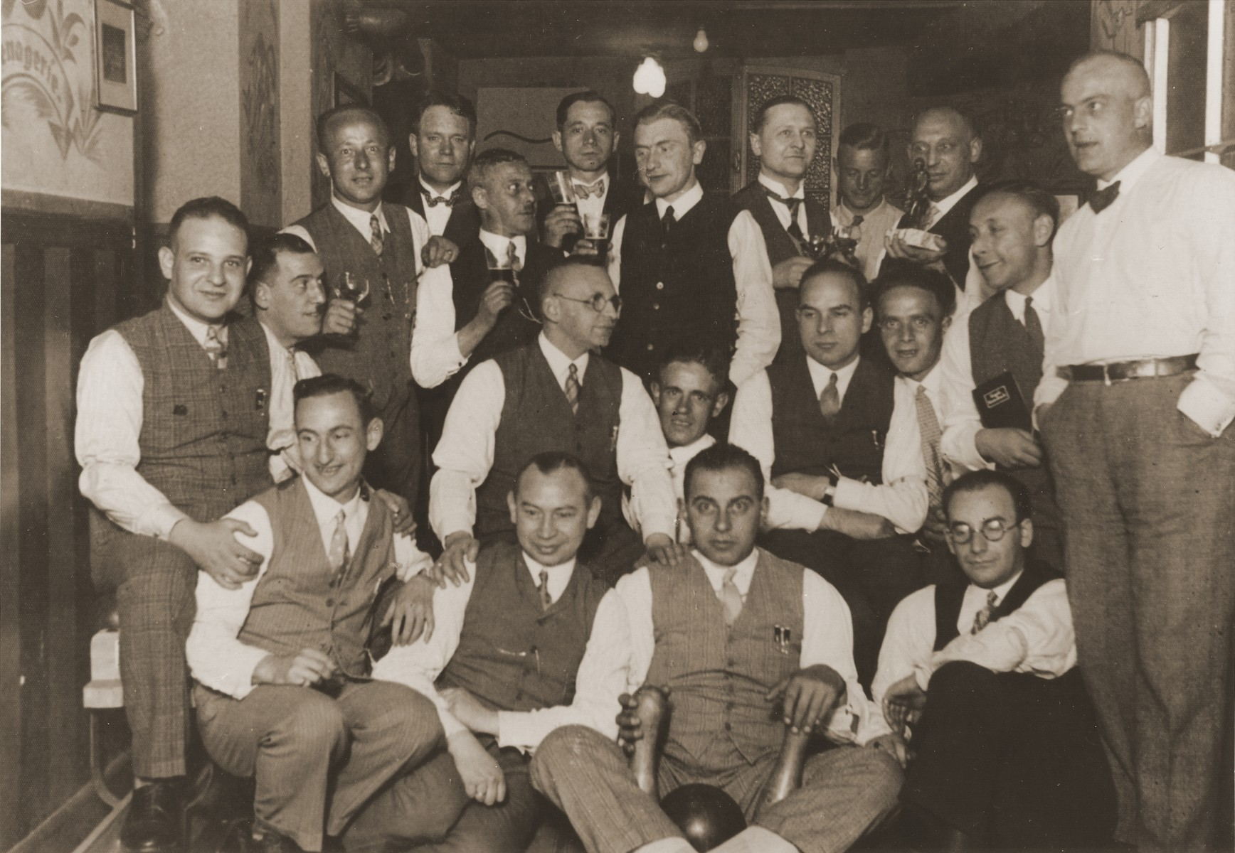 Group portrait of members of the Jewish bowling club (Kegelclub) of Essen at a match in Werden, a suburb of Essen.  Among those pictured are the donor's father, Gustav Straus (front row, right); Ludwig Schartenberg (front row third from the right); and Ernst Hoeflich (standing, far left); Luz Braunschwig; Otto Kahn; Erich Anhalt; Max Schwartz; Joseph Schwartz; Otto Schiff; and Sam Meyer.