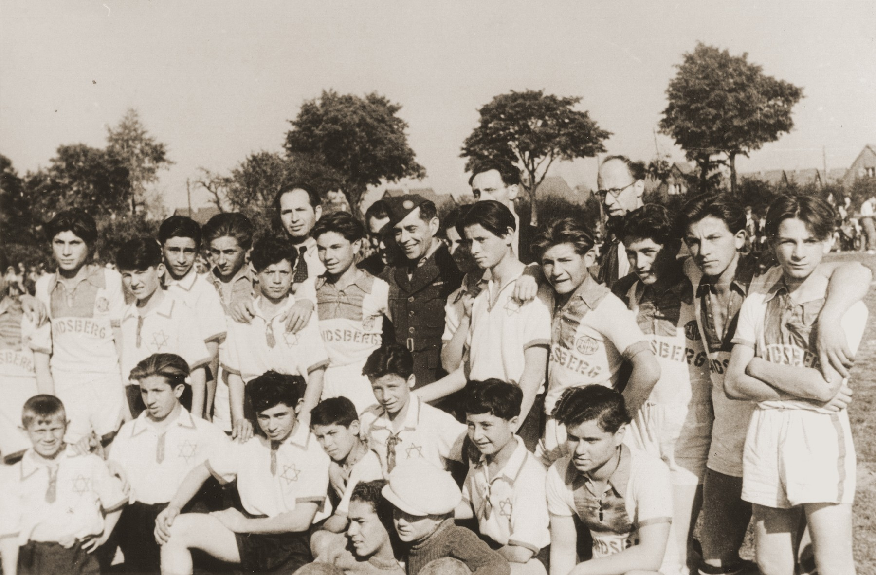 Group portrait of members of the soccer team in the Neu Freimann displaced persons camp.
