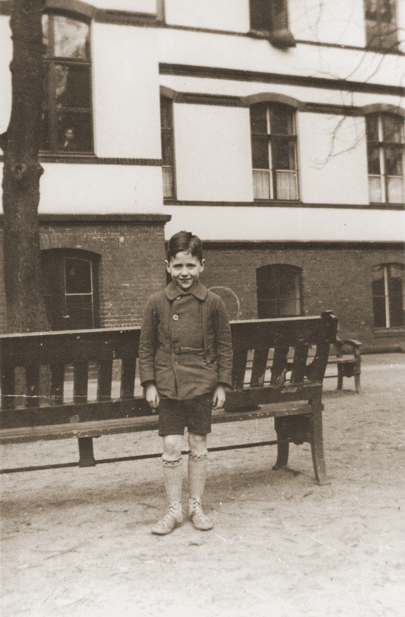 Six-year-old Heinz Stephan Lewy poses in the yard of the Baruch Auerbach Jewish orphanage in Berlin.