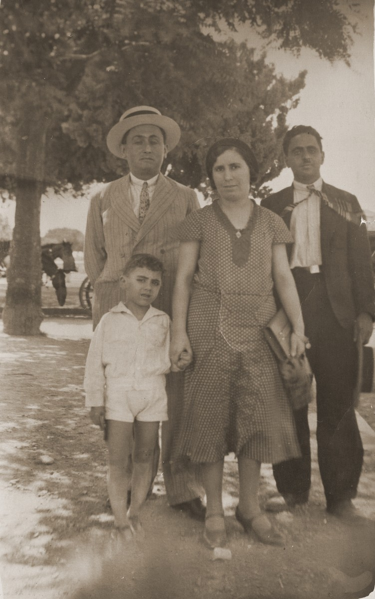 The Mordo and Mathatia families in Greece.    Pictured from right to left are the donor's father, Jacob Mordo; his aunt and uncle, Rachel and Victor Mathatia; and his brother Moses Mordo.  All perished in concentration camps.