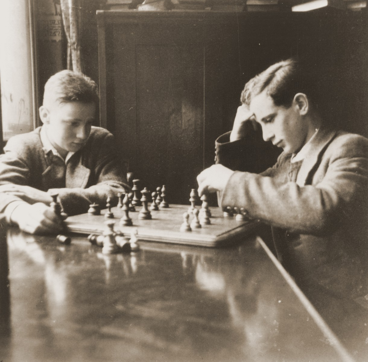 Two youths play a game of chess at the Baruch Auerbach Jewish orphanage in Berlin.