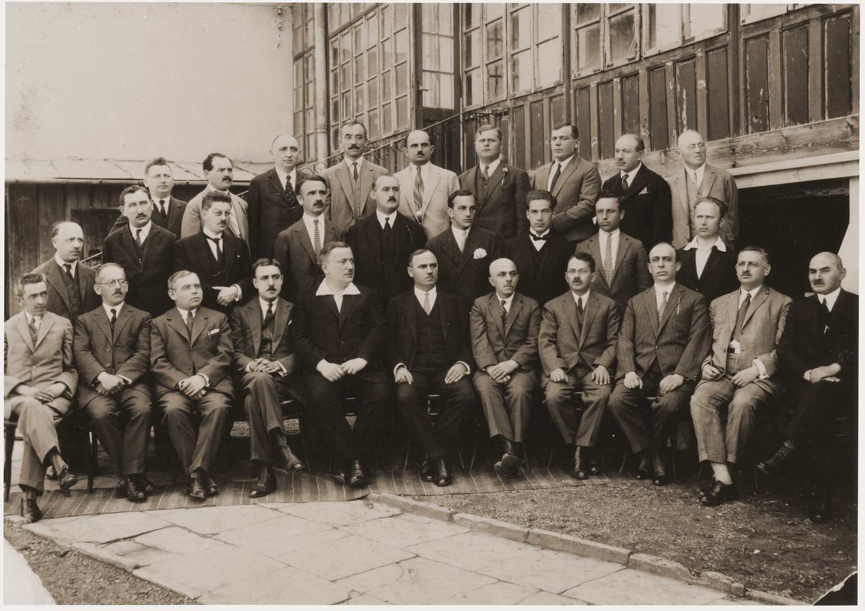 Group portrait of the faculty of the boys' public high school no. 3.  Pictured in the photograph are Professors Feuer, Hundert, Horustein, Barbasch, Pilpel, Siataru, Ignatescu, Mayer, Tyndel, Sternberg, Hoffmann, Barlion, Susuleac, Sherman, Marim, Teaciuc, Rusu, Sabor, Singer, Wachsmann, Manacatide, Schleier, Viteucu, Ordinanz, Kohan, Brenner, Last, and Wurzer.